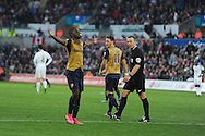 Joel Campbell of Arsenal has a 'dummy' in his mouth as he celebrates after he scores his teams 3rd goal. Barclays Premier league match, Swansea city v Arsenal  at the Liberty Stadium in Swansea, South Wales  on Saturday 31st October 2015.<br /> pic by  Andrew Orchard, Andrew Orchard sports photography.