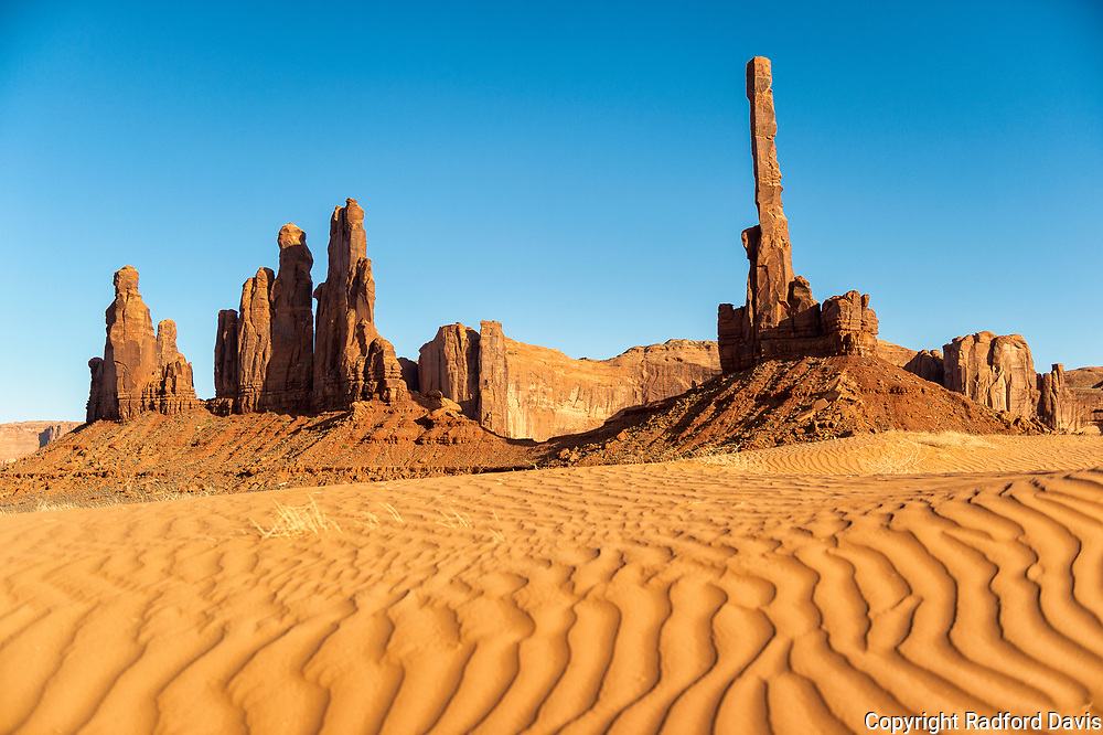 Yel-Bichel & Totem Pole in Monument Valley on the Navajo Reservation.
