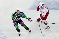 Erik Pance of Olimpija vs Michael Schiechl of Salzburg during ice-hockey match between HDD Tilia Olimpija Ljubljana (SLO) and EC Red Bull Salzburg (AUT) in 2nd Quaterfinals of EBEL league, on March 1, 2011 in Hala Tivoli, Ljubljana, Slovenia. (Photo By Vid Ponikvar / Sportida.com)