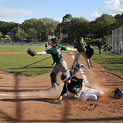 A run scores at home plate during the Norwalk Little League baseball competition at Broad River Fields, Norwalk, Connecticut. USA. Photo Tim Clayton