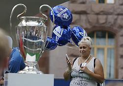 May 25, 2018 - Kiev, Ukraine - A woman looks at the Champions League trophy at the UEFA Champions League Final fan zone in Kyiv, Ukraine, 25 May, 2018. Real Madrid will face Liverpool FC in the UEFA Champions League final at the NSC Olimpiyskiy stadium on 26 May 2018. (Credit Image: © Str/NurPhoto via ZUMA Press)