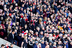 Fans in the stands applaud as the family of Gordon Banks make their way down to the pitch ahead of the funeral cortege arriving at the bet365 Stadium, Stoke.