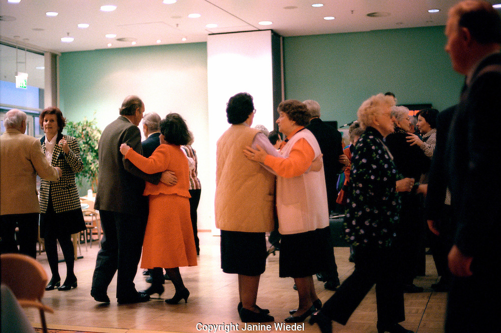 Older people at afternoon tea dance.