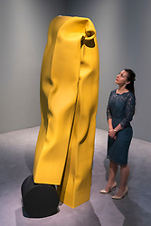 """© Licensed to London News Pictures. 07/06/2018. LONDON, UK. A staff member views """"New Moon"""", 2018, by Carol Bove at the preview of an exhibition of steel sculptures by the American artist at the David Zwirner gallery in Mayfair.  The show runs 8 June to 3 August 2018.  Photo credit: Stephen Chung/LNP"""