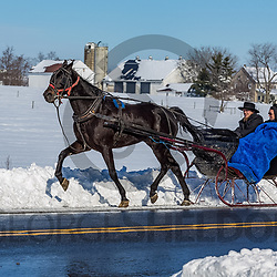 Gordonville, PA - January 24, 2016: Lancaster County Amish use a one-horse open sleigh for transportation after a snowstorm.