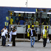 "Fenerbahce's shop ""Fenerium"" bus and supporters before their Turkish Super Cup 2012 soccer derby match Galatasaray between Fenerbahce at the Kazim Karabekir stadium in Erzurum Turkey on Sunday, 12 August 2012. Photo by TURKPIX"