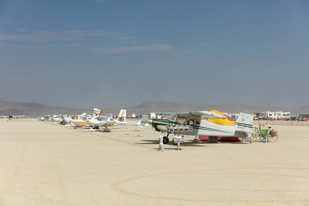 Note the tent behind the first plane. Many burners campout with their planes. My Burning Man 2018 Photos:<br /> https://Duncan.co/Burning-Man-2018<br /> <br /> My Burning Man 2017 Photos:<br /> https://Duncan.co/Burning-Man-2017<br /> <br /> My Burning Man 2016 Photos:<br /> https://Duncan.co/Burning-Man-2016<br /> <br /> My Burning Man 2015 Photos:<br /> https://Duncan.co/Burning-Man-2015<br /> <br /> My Burning Man 2014 Photos:<br /> https://Duncan.co/Burning-Man-2014<br /> <br /> My Burning Man 2013 Photos:<br /> https://Duncan.co/Burning-Man-2013<br /> <br /> My Burning Man 2012 Photos:<br /> https://Duncan.co/Burning-Man-2012