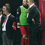 Galatasaray's coach Fatih TERIM (R) and Ayhan AKMAN (C) during their Turkish Superleague soccer match Galatasaray between Mersin Idman Yurdu at the Turk Telekom Arena at Aslantepe in Istanbul Turkey on Saturday 05 November 2011. Photo by TURKPIX