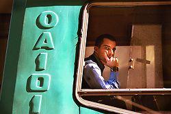 BUENOS AIRES, ARGENTINA: A man looks out the window while sitting on a bus in Buenos Aires, July 26, 2001. .(Photo by Ami Vitale)
