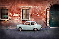 A vintage blue car in the Trastavere neighborhood of Rome, Italy.