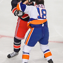 New York Rangers defenseman Stu Bickel (41) and New York Islanders center Micheal Haley (18) fight during first period NHL action between the New York Islanders and the New York Rangers at Madison Square Garden in New York, N.Y.