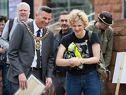 © Licensed to London News Pictures . 14/08/2016 . Manchester , UK . CLLR CARL AUSTIN-BEHAN and MAXINE PEAKE . A memorial on the site of The Peterloo Massacre ( formerly St Peter's Field , now the Manchester Central Convention Centre ) , attended by Maxine Peake and Paul Mason . On 16th August 1819 , a rally calling for Parliamentary reform , improved workers rights and against poverty was brutally suppressed by sabre-wielding cavalrymen , resulting in the deaths of fifteen people and many hundreds injured . Photo credit : Joel Goodman/LNP