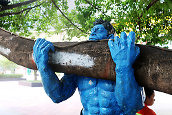 August 17, 2017 - Chongqin, Chongqin, China - Chongqing, CHINA-16th August 2017: (EDITORIAL USE ONLY. CHINA OUT)..A Hulk sculpture of blue version can be seen holding the trunk of a tree on a street in southwest China's Chongqing. (Credit Image: © SIPA Asia via ZUMA Wire)
