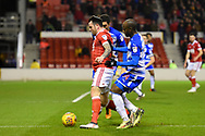 Reading forward Sone Aluko (14) pushes Nottingham Forest forward Lee Tomlin (15) during the EFL Sky Bet Championship match between Nottingham Forest and Reading at the City Ground, Nottingham, England on 20 February 2018. Picture by Jon Hobley.