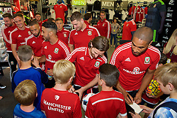 CARDIFF, WALES - Thursday, June 2, 2016: Wales' captain Ashley Williams and Joe Allen sign autographs during a visit to a JD Sports store in Llantrisant. (Pic by Ian Cook/Propaganda)