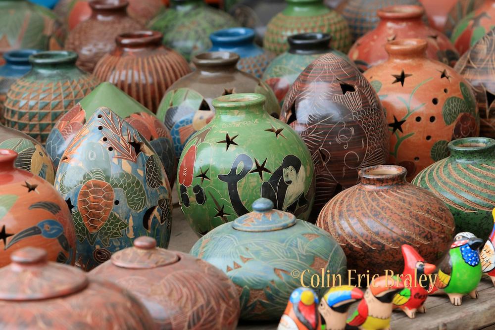 e-Closeup photo of pottery on a table on the beach at Bahia del Sol, Costa Rica. 2009 Colin E Braley/Photo