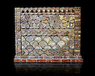 Part of an altarpiece made from enameled brick found on the forecourt of the temple-palace of Guyana /Tell Halaf. The decoration is made up of wavebands, rosettes, and semicircles that interpreted as a representing mountains. Pergamon Museum, Berlin, inv no VA14646