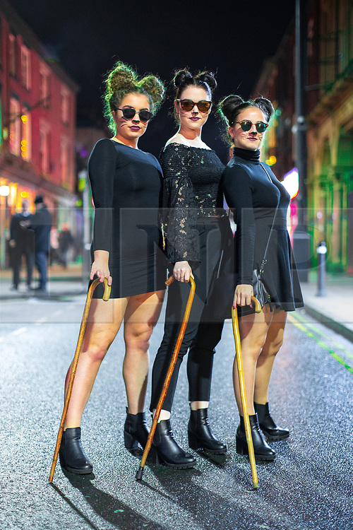 © Licensed to London News Pictures . 26/12/2017. Wigan, UK. Three Blind Mice. Revellers in Wigan enjoy Boxing Day drinks and clubbing in Wigan Wallgate . In recent years a tradition has been established in which people go out wearing fancy-dress costumes on Boxing Day night . Photo credit: Joel Goodman/LNP