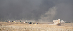 20/10/2016. Bashiqa, Iraq. An Islamic State mortar lands behind peshmerga forces as they retake the ISIS held town of Tiskharab, close to Bashiqa Iraq today (20/10/2016).<br /> <br /> Launched in the early hours of today with support from coalition special forces and air strikes, the attack is part of the larger operation to retake Mosul from the Islamic State, and involves both the Kurds and the Iraqi Army. The city of Bashiqa, around 9 miles north of Mosul, is one of several gateway areas that must be taken before any attempted offensive on Mosul itself.<br /> <br /> Despite the peshmerga suffering several casualties after militants fought back using mortars, heavy machine guns and snipers, the Kurdish forces were quickly taking ground with Haider al-Abadi, the Iraqi prime minister, stating that the operation to retake Mosul was progressing faster than expected. Photo credit: Matt Cetti-Roberts/LNP