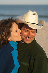 beautiful couple at the beach in fall clothing