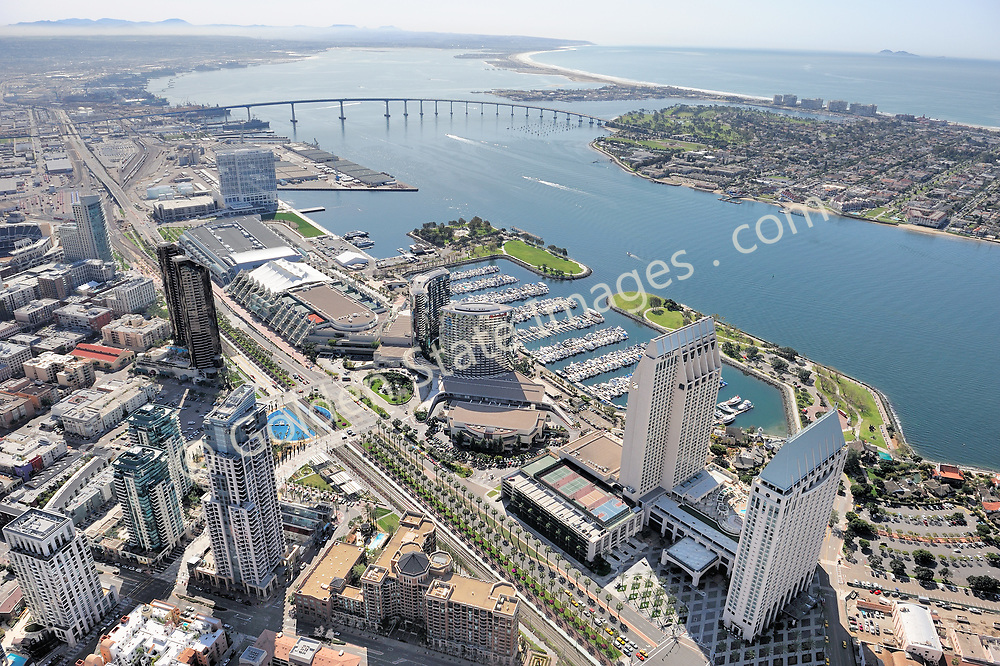 Aerial Photo.<br /> <br /> View looking south, Coronado Bridge along with South Coronado Island in background. From right to left, Hyatt hotel, Marriott Hotel, Embarcadero Marina and Park, Convention Center and Hilton Hotel.