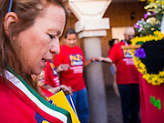 05 OCTOBER 2013 - PHOENIX, ARIZONA:   A woman prays before starting a march in Phoenix Saturday. More than 1,000 people marched through downtown Phoenix Saturday to demonstrate for the DREAM Act and immigration reform. It was a part of the National Day of Dignity and Respect organized by the Action Network.    PHOTO BY JACK KURTZ