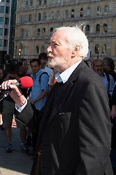 © Licensed to London News Pictures. 14/03/2014. London, UK. ARCHIVE PICTURES The late Tony Benn speaking at the Stop the War in Syria rally at Trafalgar Square, London, in August last year.  Photo credit : Simon Ford/LNP