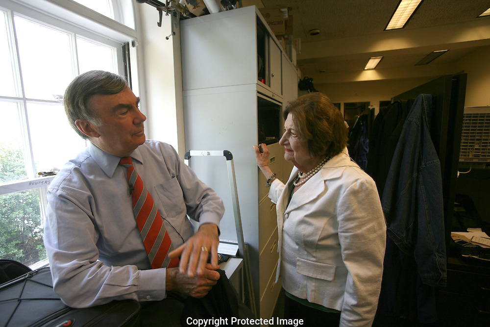ABC's Sam Donaldson  and veteran White House correspondent Helen Thomas talk in the reporters work area of the White House press area  on the last day that the White House Press Briefing Room will be open.  The Briefing room is closing for months while it undergoes a major rennovation.    Photograph: Dennis Brack