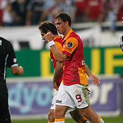 Galatasaray's Johan Elmander (C) and Besiktas's Tomas Sivok (R) celebrating his goal during their Turkish Superleague soccer derby match Besiktas between Galatasaray at the Inonu Stadium at Dolmabahce in Istanbul Turkey on Thursday, 26 August 2012. Photo by TURKPIX