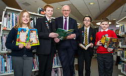 Pictured: John Swinney met  Barbara Pulawska, (10) from Bowhouse Primary School, Jack Dickson, Sophie Golding and  Jakub Rybarczyk (9) also Bowhouse Primary School during his visit.<br /> Education Secretary  John Swinney visited Grangemouth High School library today to launch the second round of bidding for a national funding programme aimed at improving school library services. <br /> <br /> <br /> Ger Harley | EEm 16 April 2018