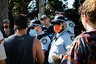 SYDNEY, NSW - SEPTEMBER 05: A policeman is seen wearing a mask during the Freedom Day Rally on September 05, 2020 in Sydney, Australia. Protesters argue COVID-19 is a hoax and say their freedoms are being unfairly impinged. Demonstrations are also taking place in every Australian capital city and several regional areas, including Byron Bay. (Photo by Lucca Markham/Speed Media)