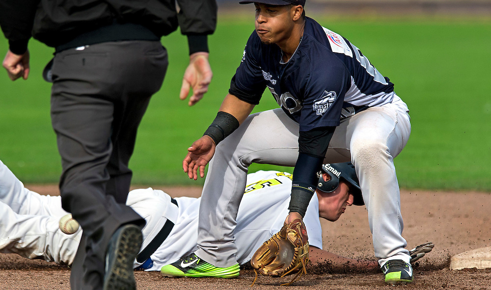 The Netherlands, Amsterdam, 05-10-2014.<br /> Baseball, Holland Series.<br /> L&D Amsterdam vs Neptunes : 1-4.<br /> Dwayne Kemp, second baseman of Neptunes, receives the ball just too late and that's why Jesse Aussems of Amsterdam is just in time to return to the second base.<br /> Photo : Klaas Jan van der Weij