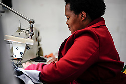 Essential workers work on producing corona-virus masks in a factory converted from manufacturing cycling apparel, in down-town Cape Town, South Africa.