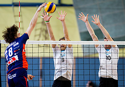 Jan Klobucar of ACH  vs Jan Pokersnik and Boris Brus of Kamnik during volleyball match between Calcit Volleyball and ACH Volley in 4th Final Round of Radenska Classic League 2012/13 on April 16, 2013 in Arena Kamnik, Slovenia. (Photo By Vid Ponikvar / Sportida)