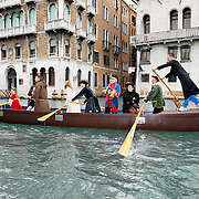 VENICE, ITALY - FEBRUARY 20:  Members of a rowing association raw along the Grand Canal during the Venetian Feast on February 20, 2011 in Venice, Italy. During the Venetian Feast a traditional water parade sails from San Marco along the Canal Grande to the  district of Cannaregio where there the crowd waits for the Svolo della Pantegana   (flight of the mouse).