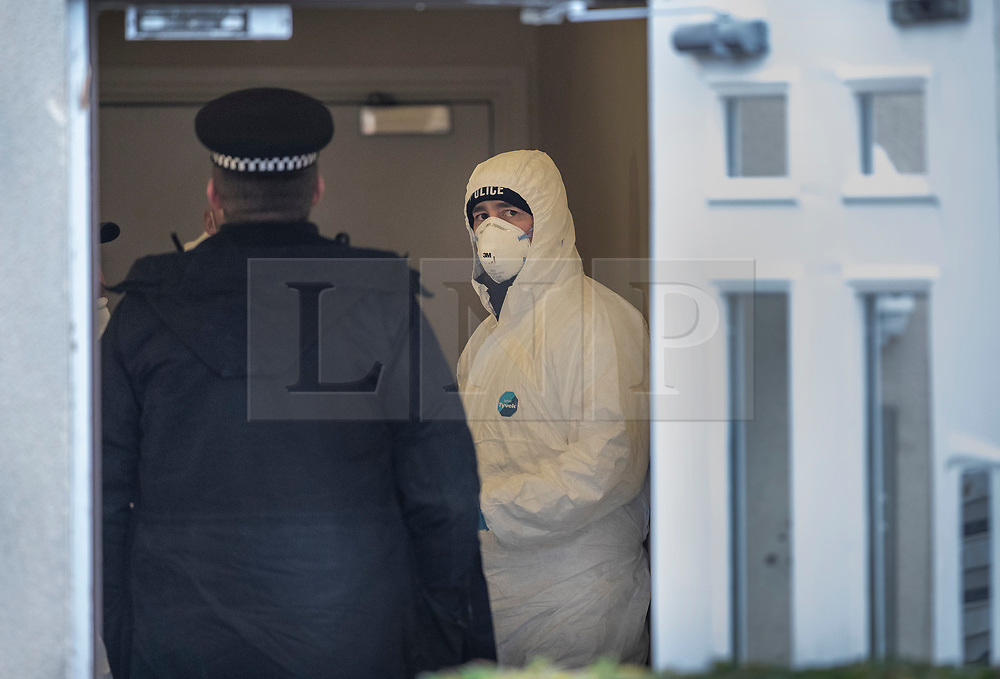 © Licensed to London News Pictures. 05/01/2019. Farnham, UK. Police forensics officers search in the hallway of a property in Farnham, Surrey after a couple were arrested in connection with the murder of a man on a train yesterday. A murder investigation has been launched after the man was attacked while on board the 12. 58pm train service travelling between Guildford and London Waterloo. A man and a woman have been detained by police in Farnham in connection with the murder. Photo credit: Peter Macdiarmid/LNP