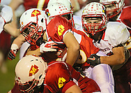 Marion's Colton Mowry (28) is hit by Maquoketa's Ty Thede (50) on a run during the first half of the game between Maquoketa and Marion at Thomas Park Field in Marion on Friday, September 21, 2012.