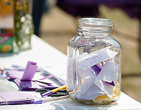 A memory jar sits filled with personal notes from friends of Lily Johnson at the memorial gathering held along Lake Opechee Saturday afternoon.   (Karen Bobotas/for the Laconia Daily Sun)