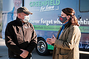 "27 OCTOBER 2020 - MARSHALLTOWN, IOWA: DAVE DEGNER, left, a Democratic candidate for the Iowa State Senate, talks to THERESA GREENFIELD during a Greenfield campaign visit to the UnityPoint Health complex in Marshalltown. Greenfield, the Democratic candidate for US Senate, visited UnityPoint Health - Marshalltown Medical Park in Marshalltown, about 55 miles from Des Moines, and talked to administators and local officials about jobs at the medical center and the need for rural healthcare. It was a part of her ""Jobs That Need to Get Done"" tour and Get Out the Vote efforts before the Nov. 3 election. Greenfield is running against incumbent US Senator Joni Ernst, a Republican.            PHOTO BY JACK KURTZ"