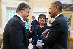 President Barack Obama talks with President Petro Poroshenko of Ukraine and Commerce Secretary Penny Pritzker following a bilateral meeting in the Oval Office, Sept. 18, 2014. (Official White House Photo by Pete Souza)<br /> <br /> This official White House photograph is being made available only for publication by news organizations and/or for personal use printing by the subject(s) of the photograph. The photograph may not be manipulated in any way and may not be used in commercial or political materials, advertisements, emails, products, promotions that in any way suggests approval or endorsement of the President, the First Family, or the White House.