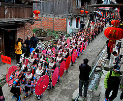 """People of Dong ethnic group perform a folk parade at Meilin Village in Meilin Township under Dong Autonomous County of Sanjiang, south China's Guangxi Zhuang Autonomous Region, March 10, 2016. People of Dong ethnic group attend a local song festival to greet the coming of Er Yue Er, or the second day of the second month on the Chinese lunar calendar, which falls on March 10 this year. Chinese people call it the day when the """"dragon raises its head"""", which means the spring awakens after winter hibernation. EXPA Pictures © 2016, PhotoCredit: EXPA/ Photoshot/ Liang Kechuan<br /> <br /> *****ATTENTION - for AUT, SLO, CRO, SRB, BIH, MAZ, SUI only*****"""