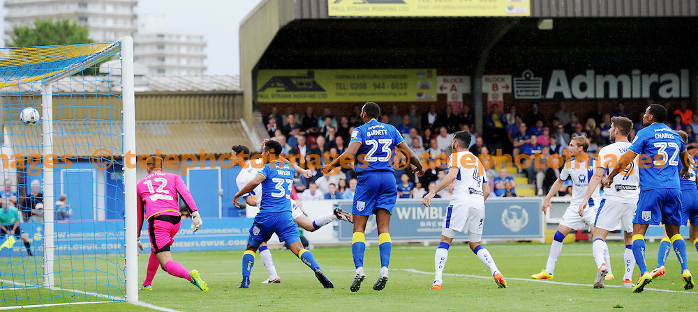 The Wimbledon players start to celebrate as Paul Robinson of AFC Wimbledon scores their first goal with a header during the Sky Bet League 1 match between AFC Wimbledon and Chesterfield at the Cherry Red Records Stadium in Kingston. September 3, 2016.<br /> Simon  Dack / Telephoto Images<br /> +44 7967 642437