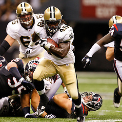 August 21, 2010; New Orleans, LA, USA; New Orleans Saints running back Chris Ivory (48) runs through a hole against the Houston Texans during the second quarter of a preseason game at the Louisiana Superdome. Mandatory Credit: Derick E. Hingle