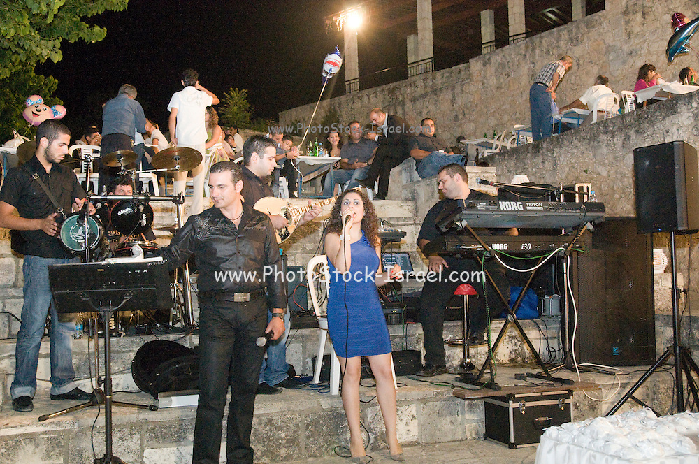 Cyprus, Lysos, A typical Cypriot Greek wedding in the town square all are invited. Three thousand people from the village and near by villages were expected. The band.