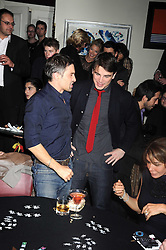 Left to right, OLIVIER MARTINEZ and JOSH HARTNETT at a party to celebrate the launch of Hollywood Domino - a brand new board game, held at Mosimann's 11b West Halkin Street, London on 7th November 2008.  The evening was in aid of Charlize Theron's Africa Outreach Project.