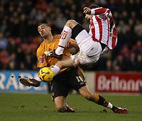 Photo: Mark Stephenson.<br />Stoke City v Wolverhampton Wanderers. Coca Cola Championship. 13/01/2007.<br />Stoke's Danny Higginbotham challenges Wolves no 18 Graig Davies (L).