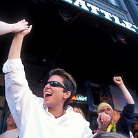 USA, Washington, Seattle, Patrons celebrate Seattle Mariners baseball playoff win at Triangle Pub in Pioneer Square
