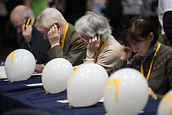 © Licensed to London News Pictures . 14/03/2015 . Liverpool , UK . Party activists canvassing on phone banks at the conference . The Liberal Democrat Party Conference at the Arena and Conference Centre in Liverpool . Photo credit : Joel Goodman/LNP