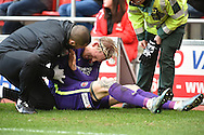 Simon Makienok of Charlton Athletic receives treatment after falling over the advertising boards during the Sky Bet Championship match between Rotherham United and Charlton Athletic at the New York Stadium, Rotherham, England on 30 January 2016. Photo by Ian Lyall.