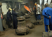 UK - Friday, Aug 01 2008:  Workers at the Whitechapel Bell Foundry in London pour molten metal into the cast of the 6th bell. (Photo by Peter Horrell / http://www.peterhorrell.com)